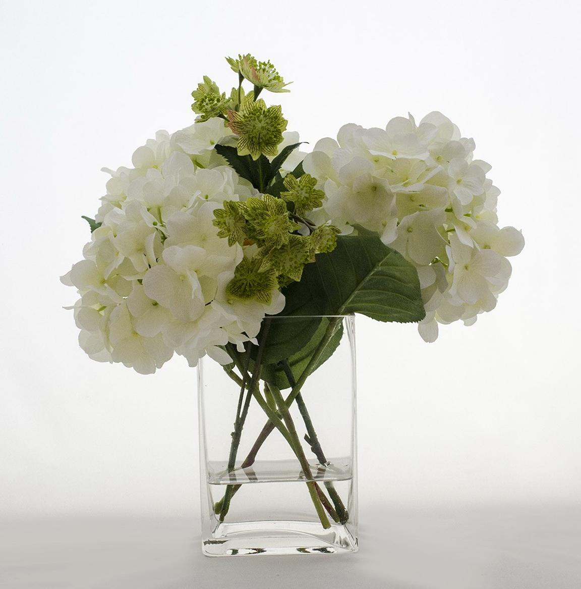 Faux Hydrangea Arrangement In Clear Glass Vase