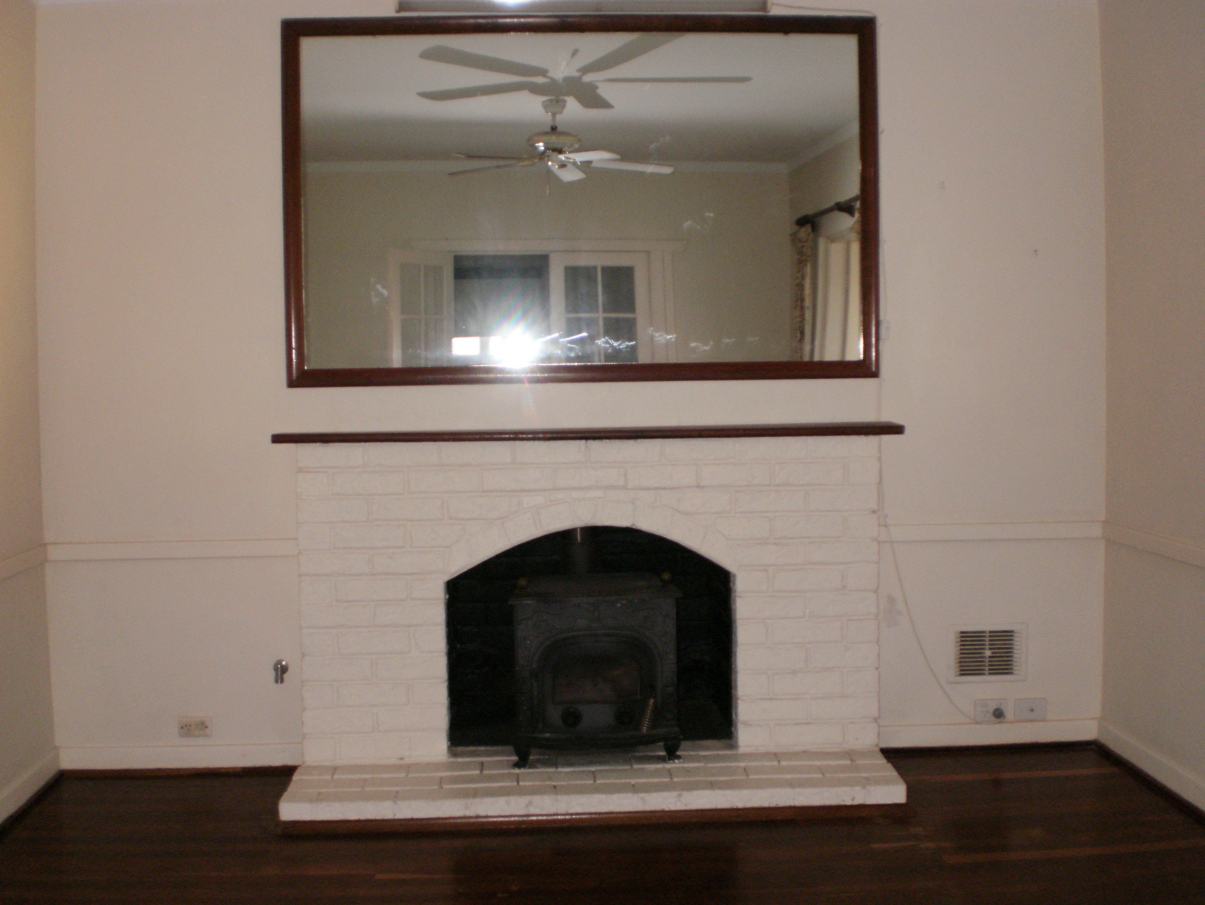 Large Mirror Over Fireplace