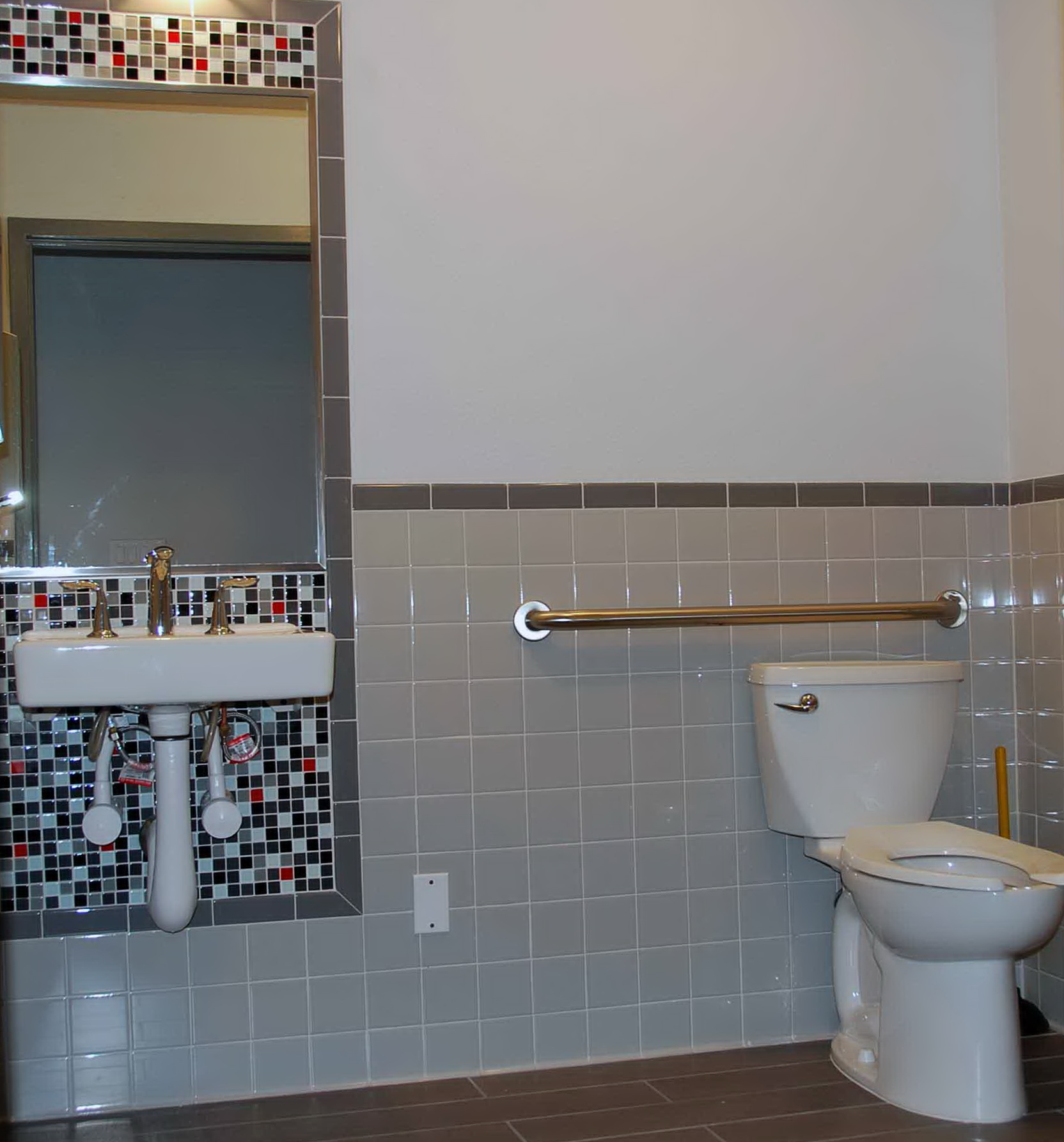 Mosaic Tiles Around Bathroom Mirror