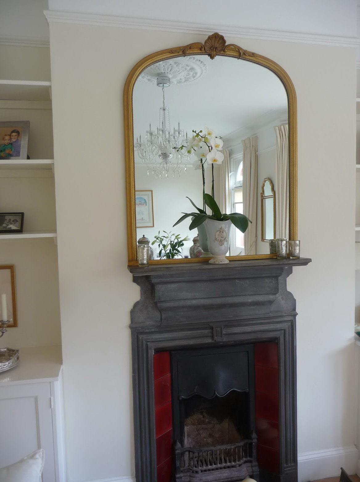 Round Mirror Over Fireplace
