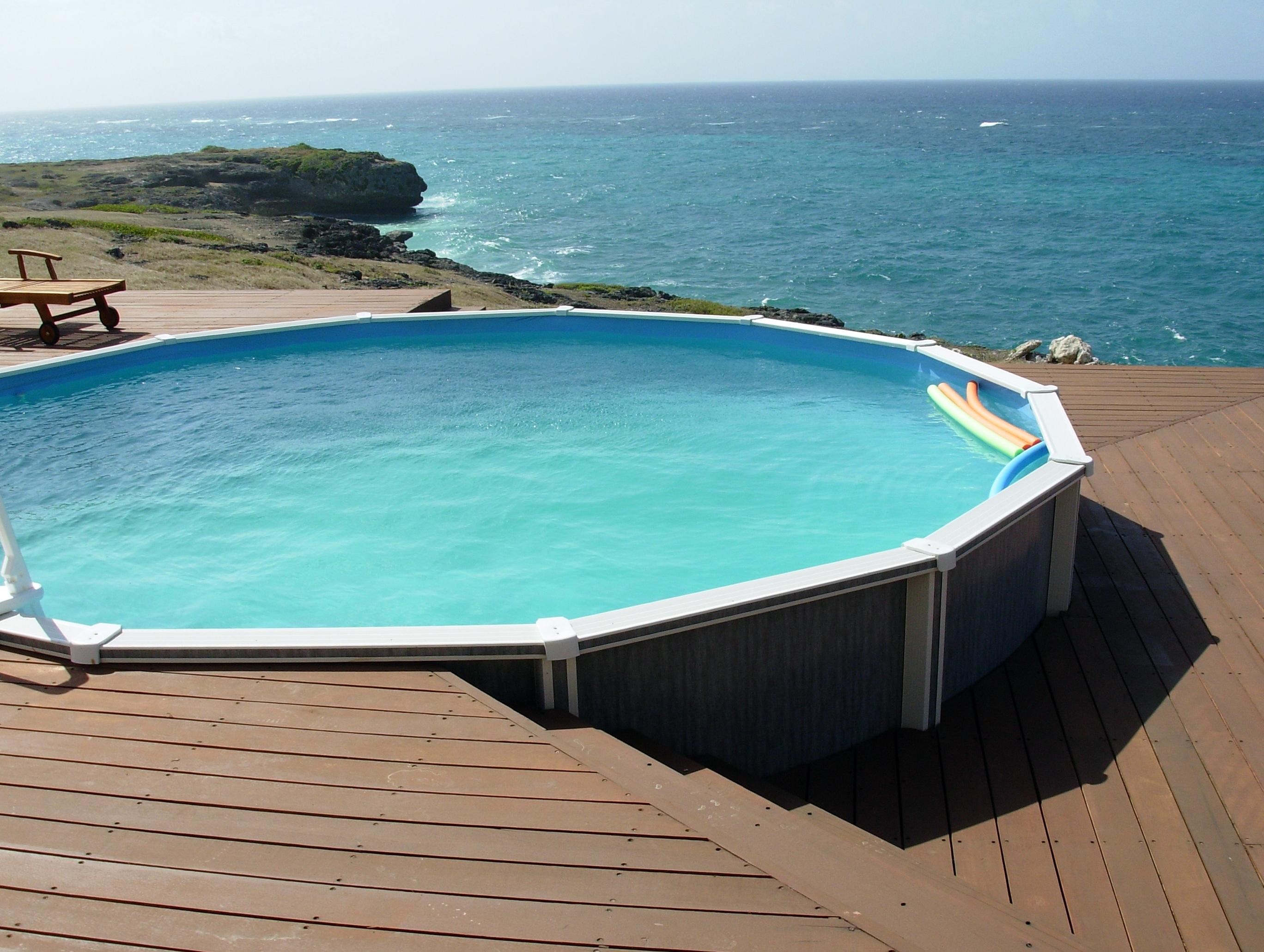 Above ground pool decks ideas home design ideas for Hillside pool ideas