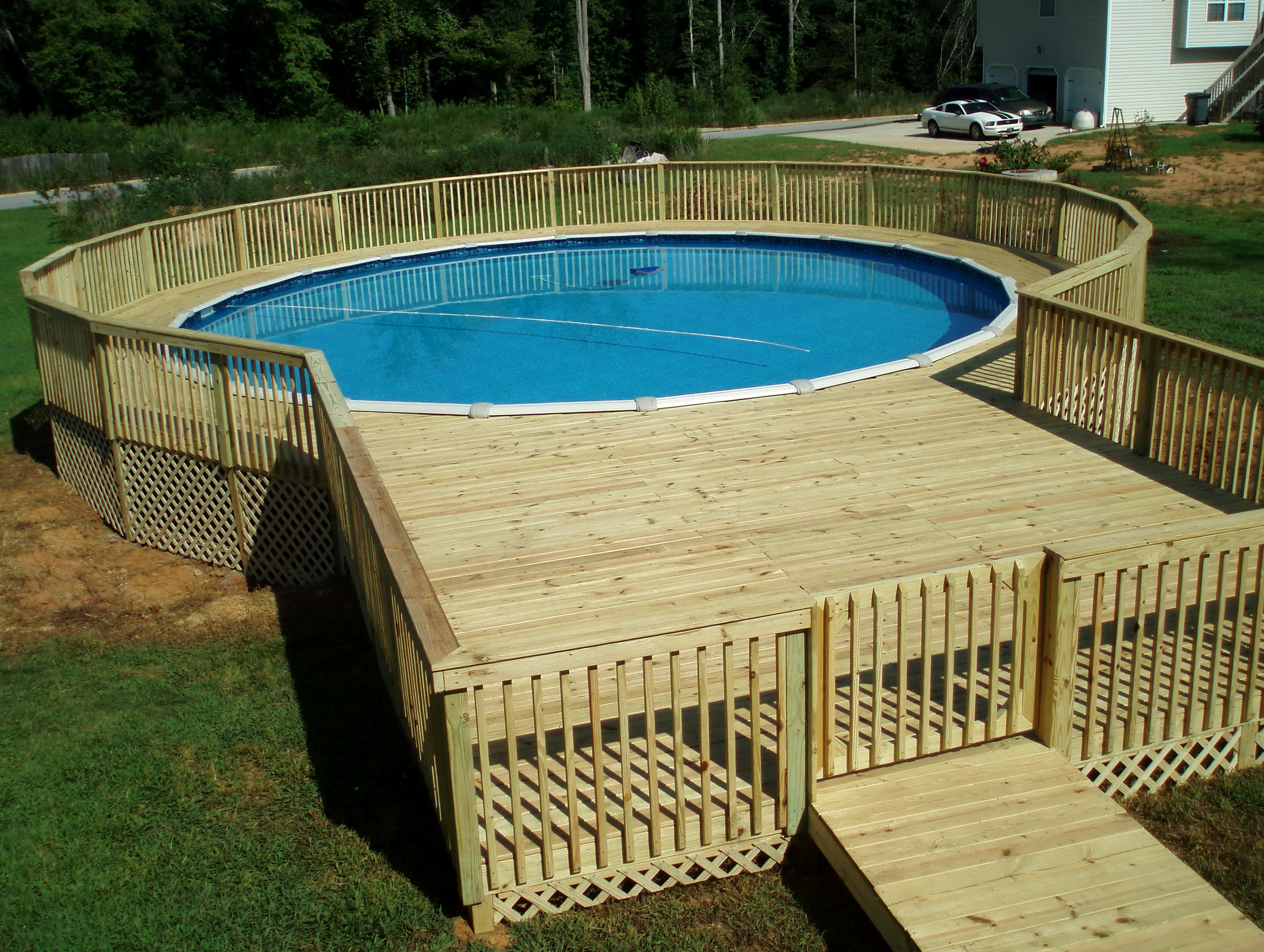 Above ground pool decks pictures home design ideas for Above ground pool decks images