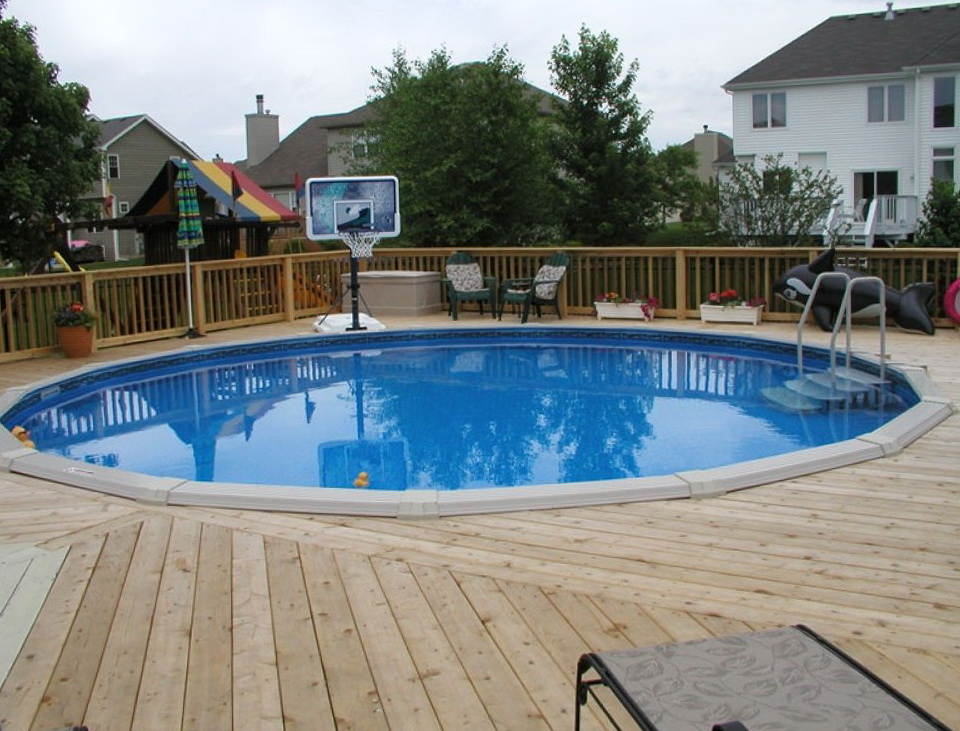 Pictures of above ground pools with decks around it home for Decor around swimming pool