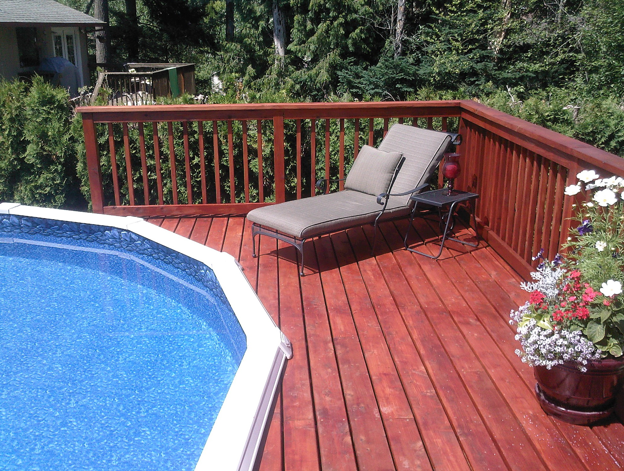 Cheap deck ideas for above ground pools home design ideas for Pool deck decor ideas