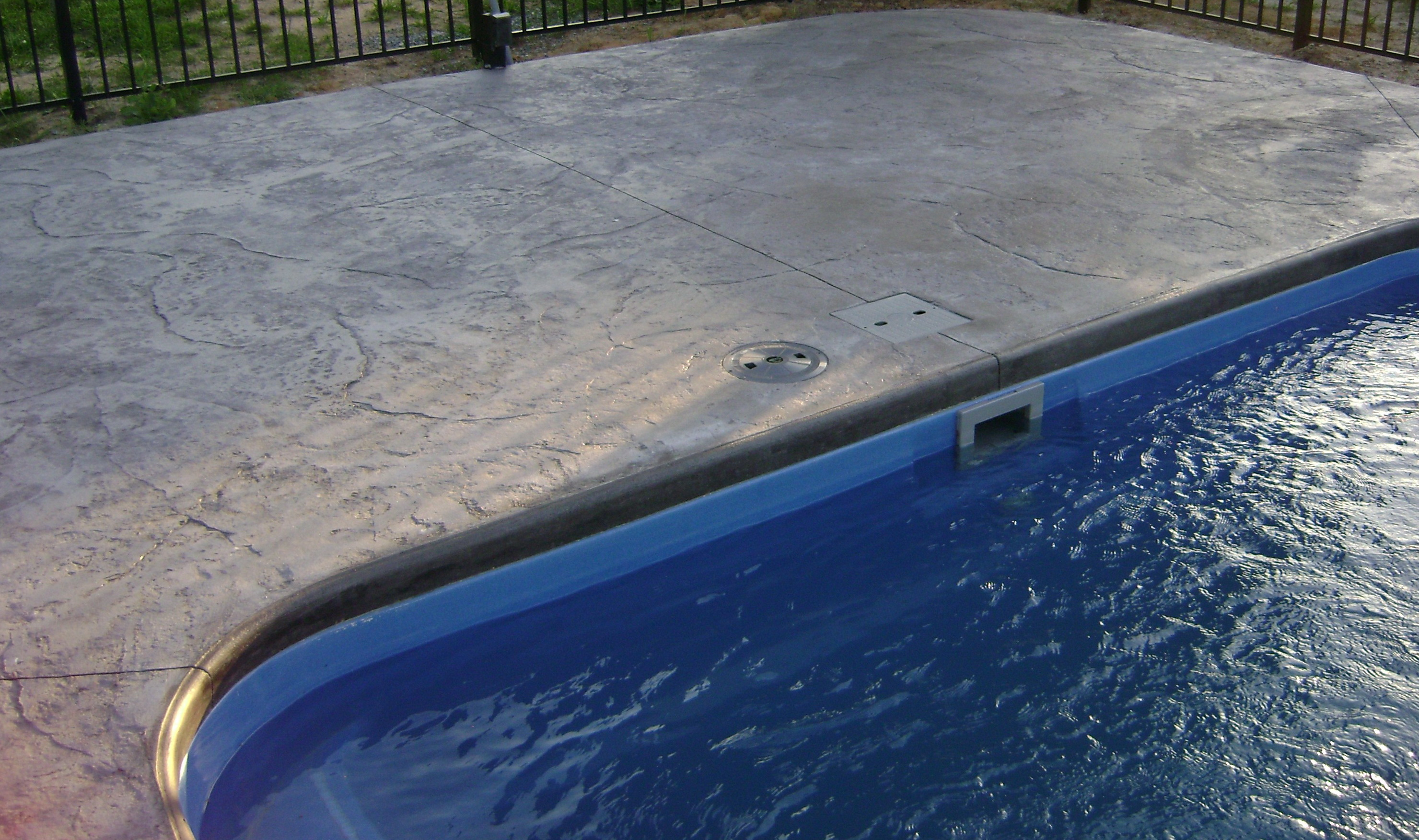Pool Deck Pavers Vs Stamped Concrete Home Design Ideas