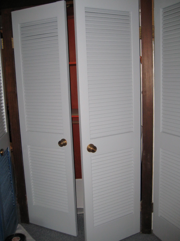 Louvered sliding closet doors closet doors for sale for Hanging sliding doors home depot
