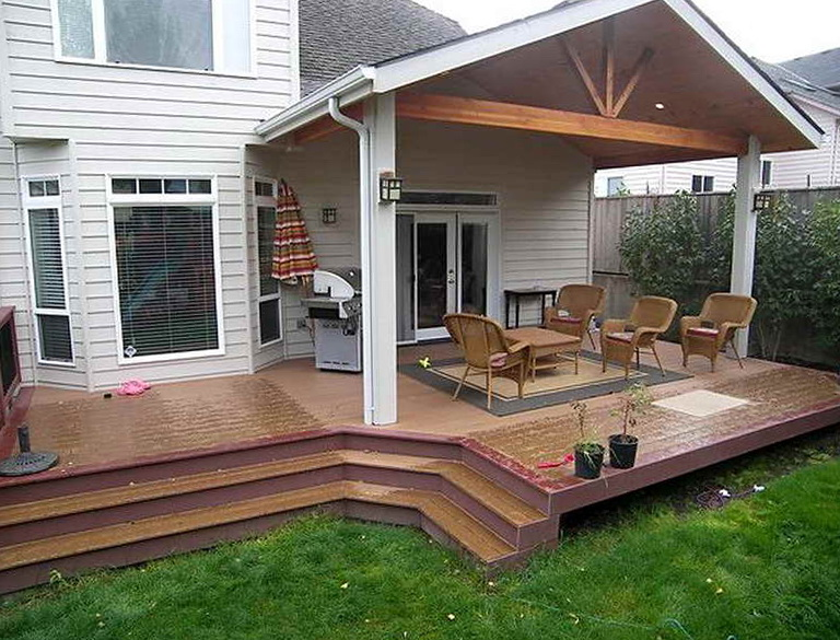 Partially covered deck ideas home design ideas for Covered porch flooring options