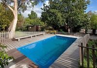 above ground pools with decks around them