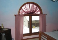 Curtains Over Arched Window